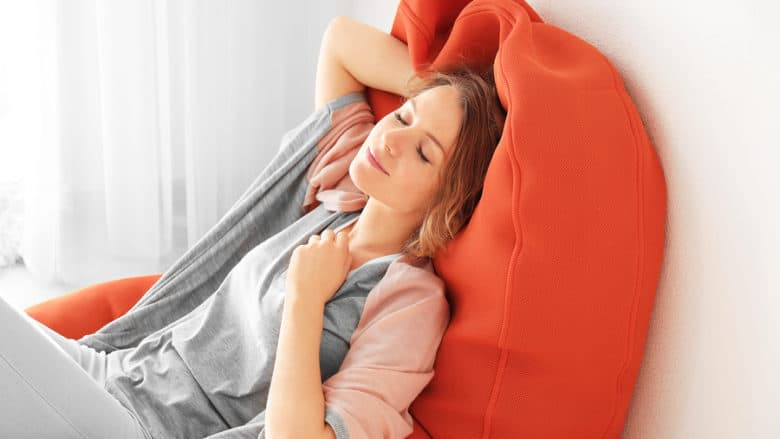 Woman relaxing on armchair
