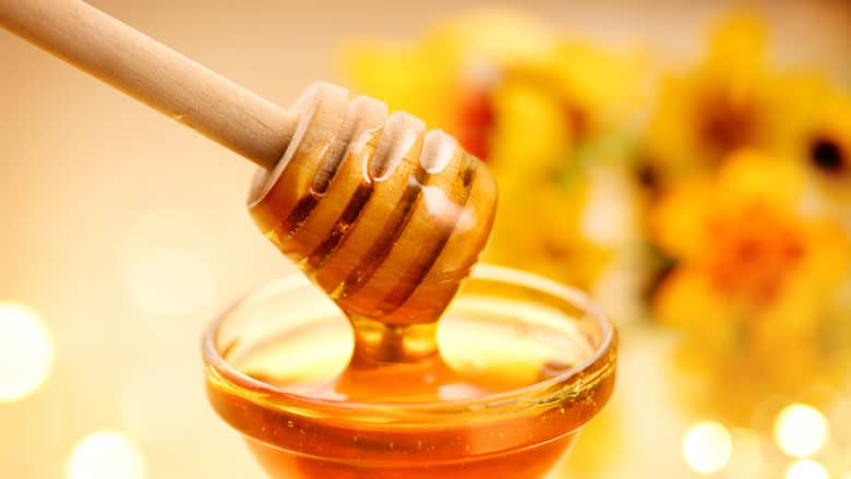 Honey dripping from honey dipper