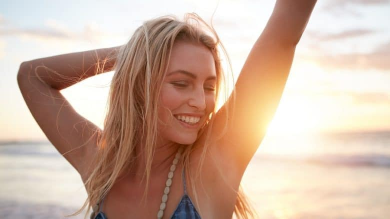 Smiling Young Caucasian Woman At The Beach